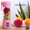 "Pink portable USB smoothie blender with fruit inside and beside. With text that says ""convenient"" and a fern in the background along side a logo that says ""silicone Kitchen"""