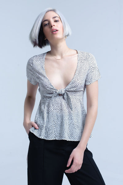 White Polka Dot Top With Ruffle Hem