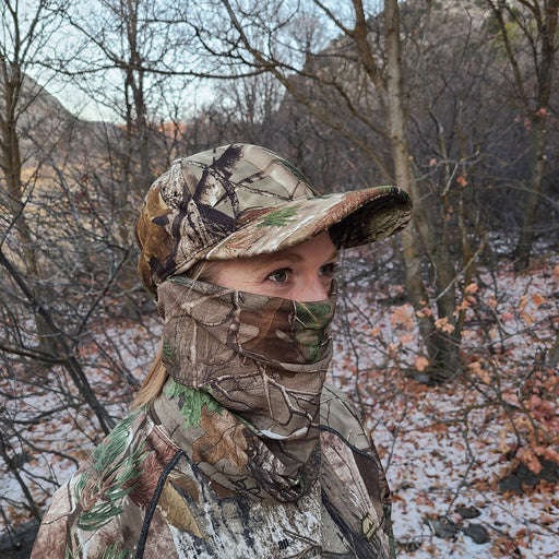 Women in Forest Wearing a Realtree Xtra Face Mask QuikCover