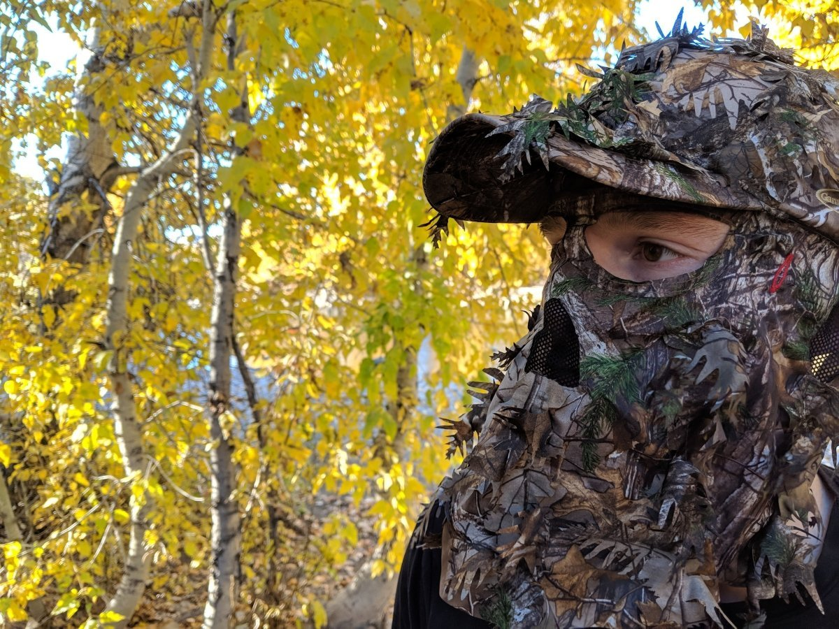 Realtree Xtra Leafy Camo Face Mask Hat in Fall with Yellow Leaves in the background by QuikCamo