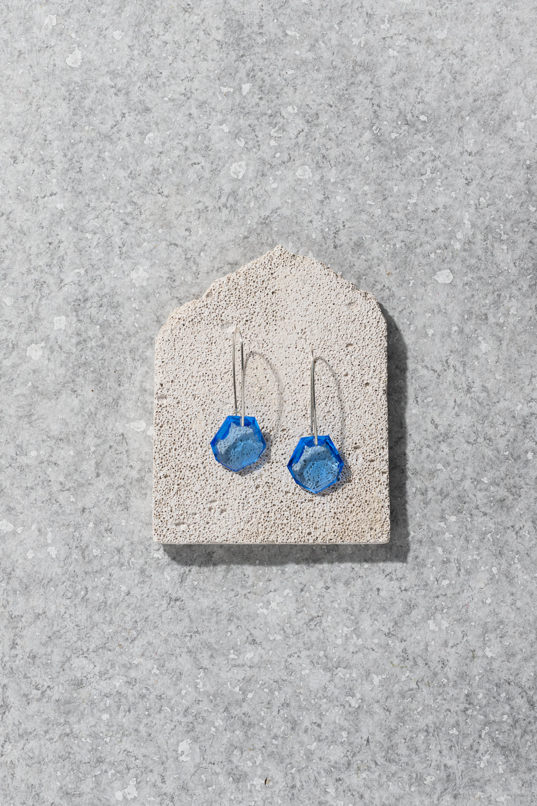1930s Czechoslovakian glass heptagon earrings – blue
