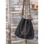 Maria Bucket Bag in Black with Brown Trim
