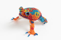 Frog: medium; brilliant red, blue, orange, yellow
