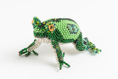 Frog: medium; yellow-green, black, green, peacock-green