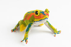 Frog; large; luster yellow-green, red, blue, orange, yellow