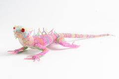 Lizard: large; pink with pale blue, yellow, and green