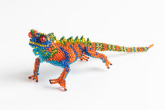 Lizard: medium; orange, bright blue, yellow, green
