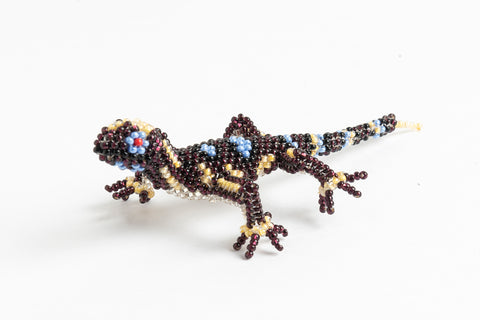 Lizard; small; purple with light blue and yellow spots