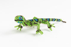 Lizard: small; bright green with bright blue spots; bronze stripes