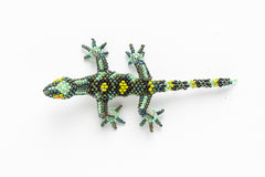 Lizard: small; turquoise and peacock green; light green spots