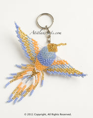 Hummingbird, fringe tail, large  pastel blue/orange/ gold head [Birds]