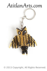Owl small black & gold [Birds]