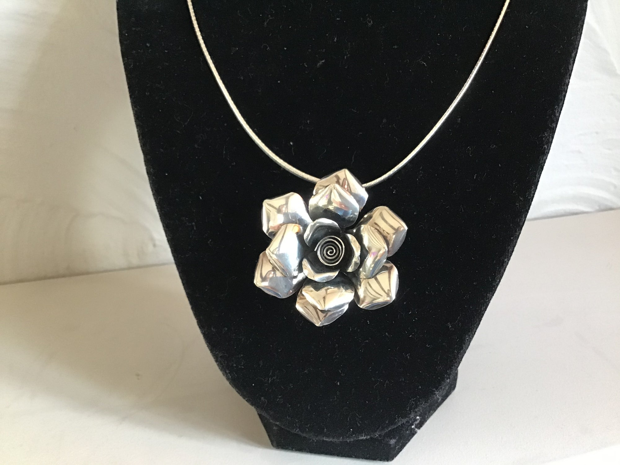Beautiful Sterling Silver flower on a silver chocker