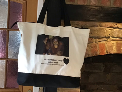 A orangutan Weather the Storm Independent and Work Ready shopping bag