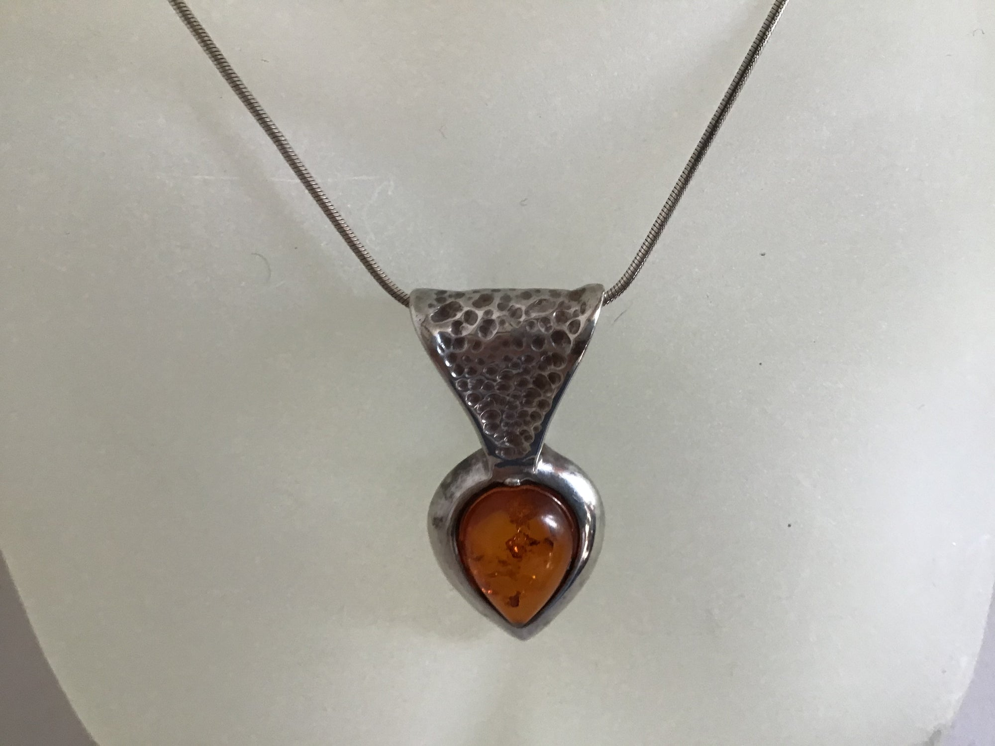 Hand hammered Silver 925 Amber and silver drop pendent on a sterling silver chain