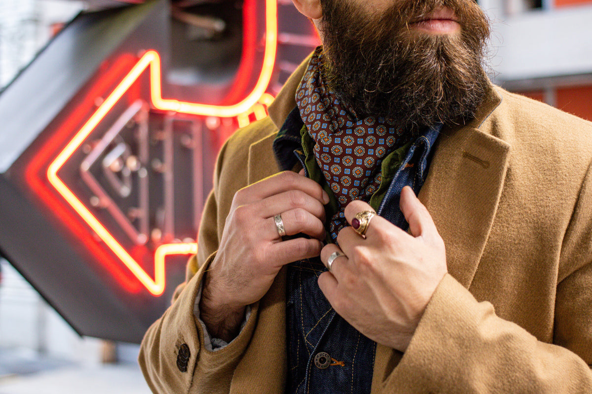 City gent wearing tan wool jacket with 'The Koenji' style paisley scarf from Soho Scarves.