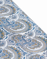 Angled view of the scarf, highlighting the detailing of the blue and yellow paisley patterns.
