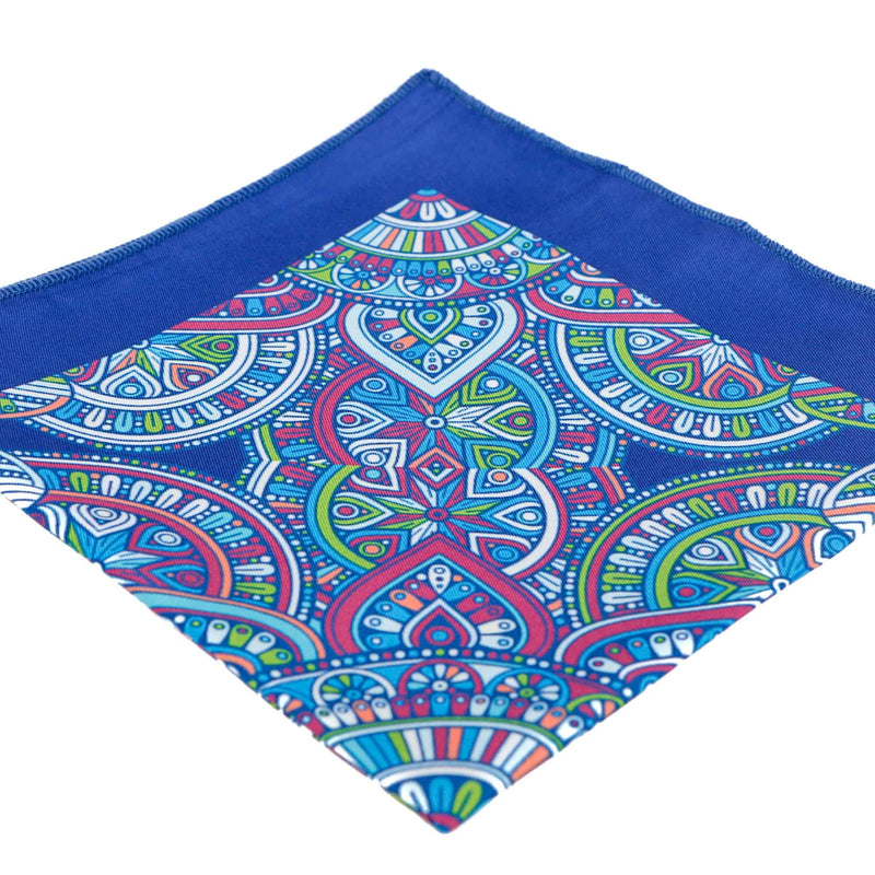 Perspective view of the handkerchief with blue border and red, green and light blue decorative patterns.