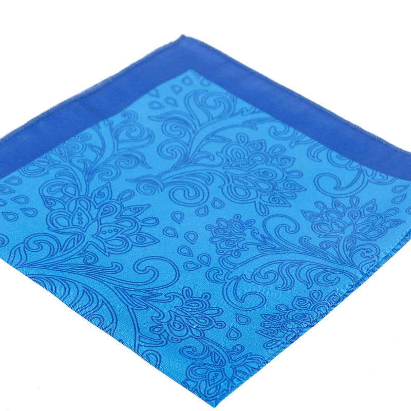 Perspective view of the handkerchief with light and darker blue paisley-inspired decorative patterns.