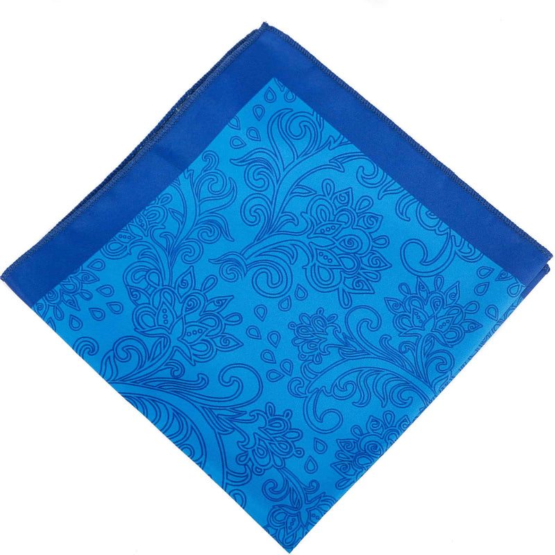 Flat view of the 'Simida' sky-blue pocket square arranged in a diamond shape, clearly showing the dark blue border, hand rolled ends and paisley inspired patterns.