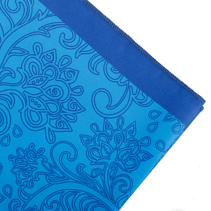Focus on the hand rolled hems of the polyester decorative handkerchief and a closer look at the blue paisley decoration.