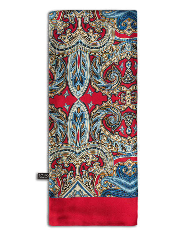 'The Aoyama' fleur-de-lis silk scarf arranged in a rectangular shape, clearly showing the rich, deep-red fabric with cream, brown and pale-blue patterns and the 'Soho Scarves' branding label on the bottom left edge.