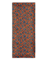 'The Asakusa' paisley polyester scarf arranged in a rectangular shape, clearly showing the vibrant orange fabric and the 'Soho Scarves' label on the left edge.