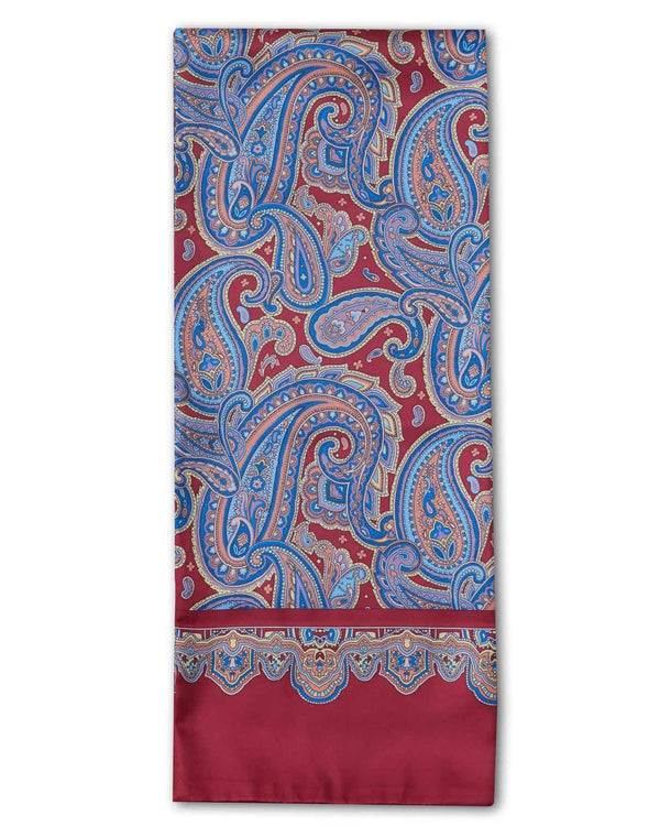 'The Hedge' paisley polyester scarf arranged in a rectangular shape, clearly showing the deep red fabric with blue paisley patterns and the 'Soho Scarves' label on the left edge.
