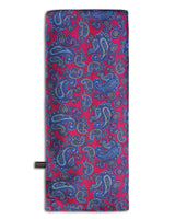 'The Kita' paisley patterned silk scarf arranged in a rectangular shape, clearly showing the fuchsia fabric with blue-violet paisley patterns and the 'Soho Scarves' branding label on the bottom left edge.