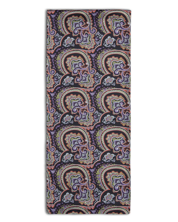 'The Quadrant' paisley-inspired polyester scarf arranged in a rectangular shape, clearly showing black with violet, yellow and orange accent fabric and the 'Soho Scarves' label on the left edge.