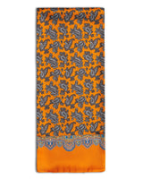 'The Richmond' paisley-inspired silk scarf arranged in a rectangular shape, clearly showing vibrant orange fabric with brown paisley patterns and the 'Soho Scarves' label on the left edge.