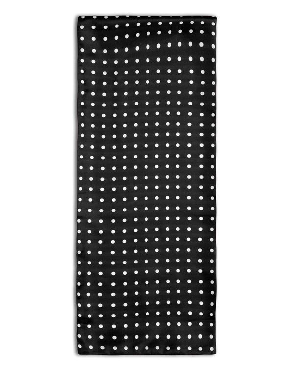 'The Shinagwa' polka-dot polyester scarf arranged in a rectangular shape, clearly showing the black fabric with white dots and the 'Soho Scarves' label on the left edge.