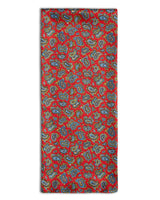 'The Shinjuku' paisley polyester scarf arranged in a rectangular shape, clearly showing the red coloured fabric and the 'Soho Scarves' label on the left edge.