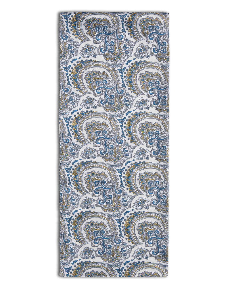 'The Tyler' paisley polyester scarf arranged in a rectangular shape, clearly showing light coloured fabric with blue and yellow paisley patterns, and the 'Soho Scarves' label on the left edge.