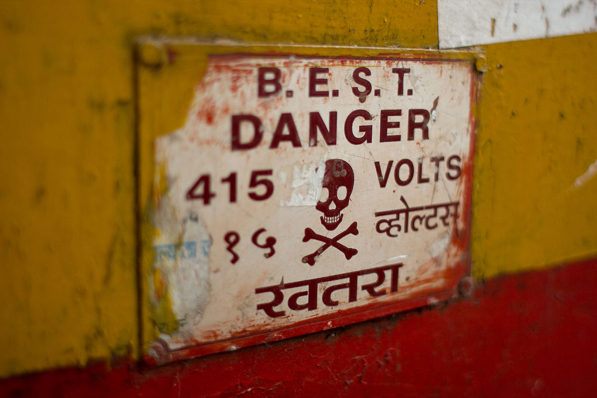tamed winds t-shirt shop and blog, a skull and crossbones warning about dangerous voltage in mumbai india