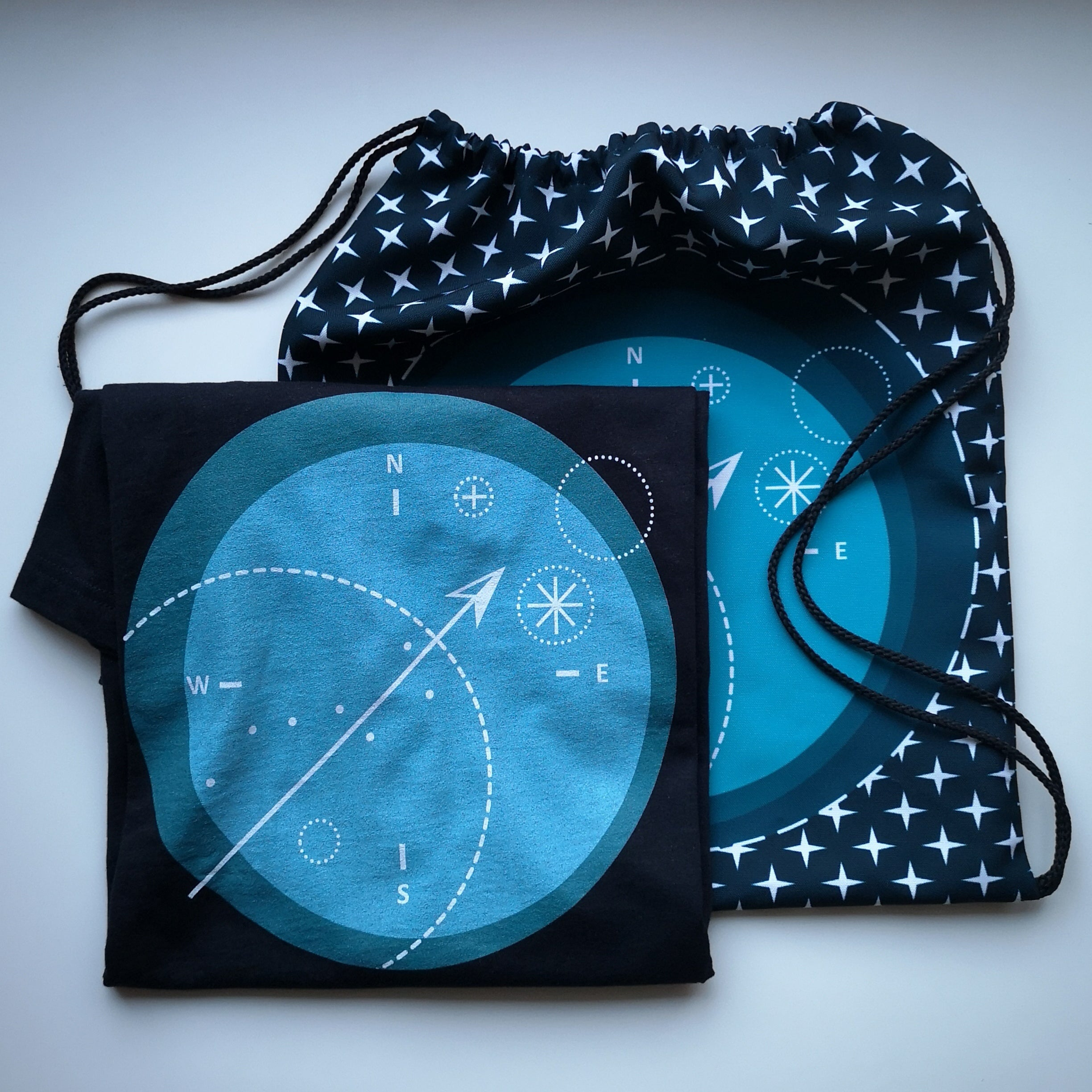 compass t shirt and drawstring bag tamed winds t shirt shop and blog