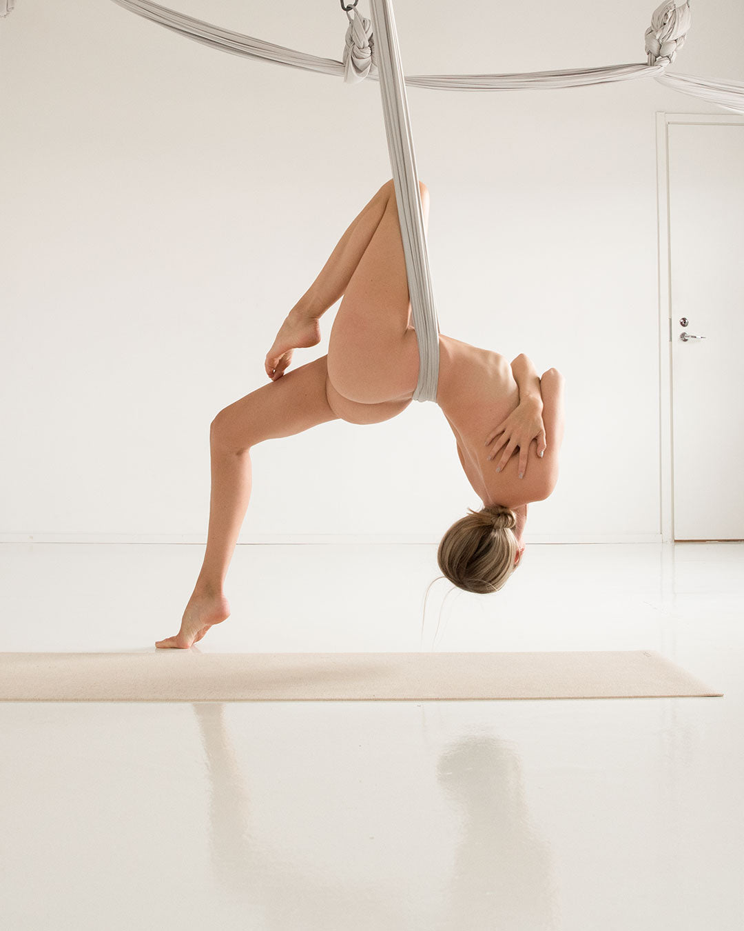 Yoga girl practicing aerial yoga