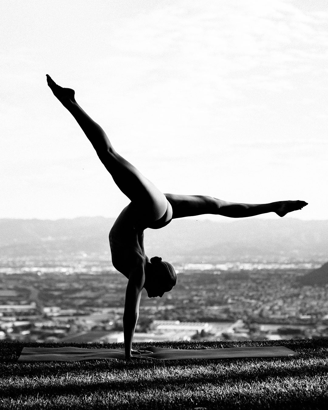 Yoga photography of woman doing headstand