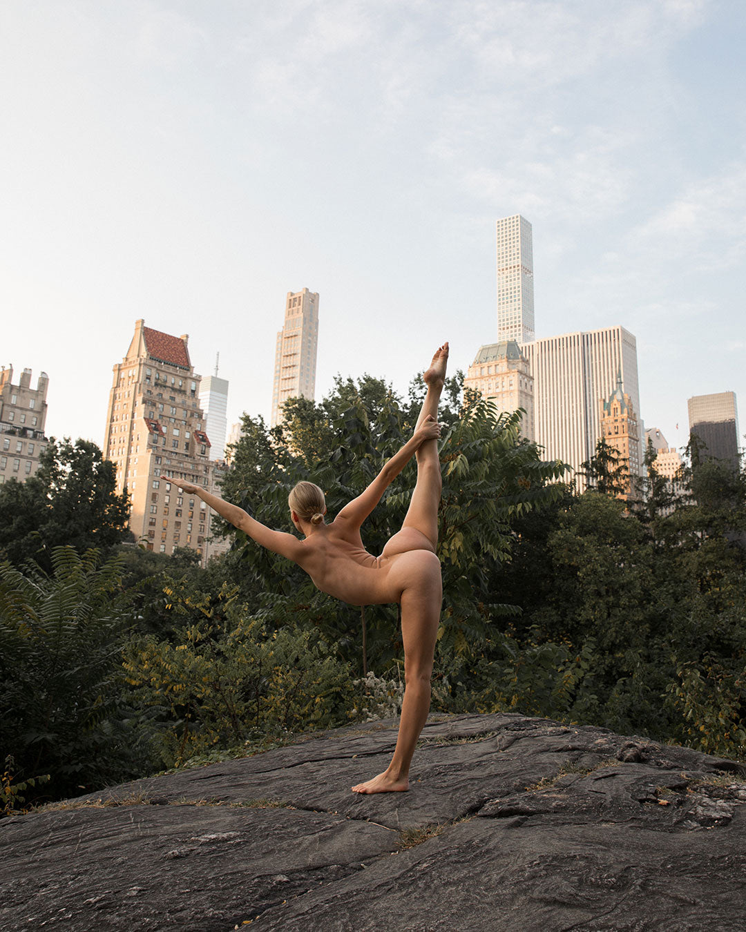 Woman posing nude in central park