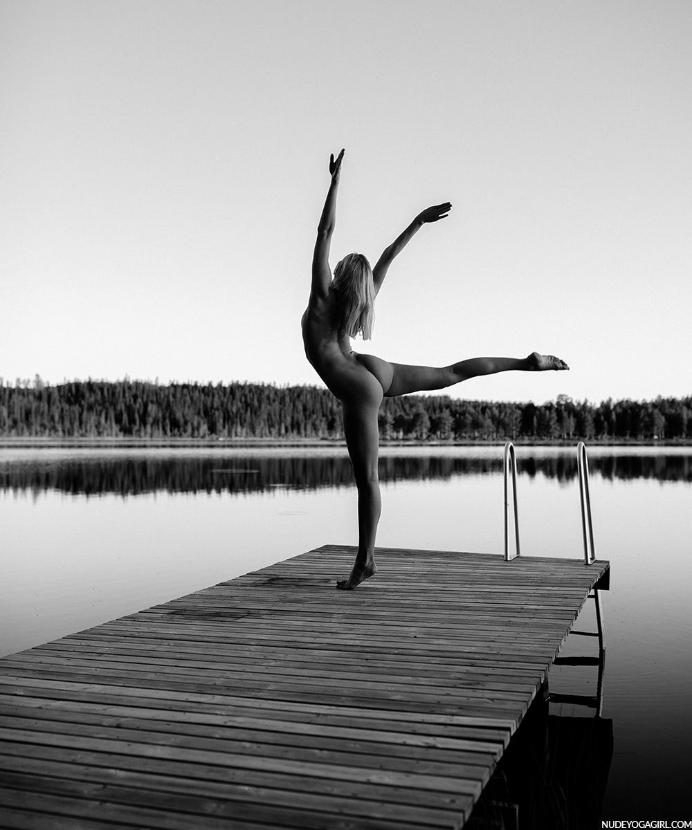 nude yoga girl practicing yoga on a lake in lapland blog post article