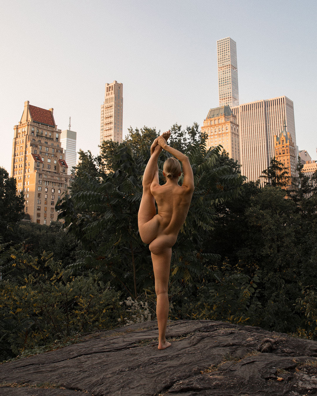 Woman posing during nude photoshoot in central park