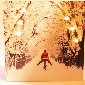 UK Gardens 40cm LED Light Santa on Bike Canvas Picture Christmas Wall Decoration