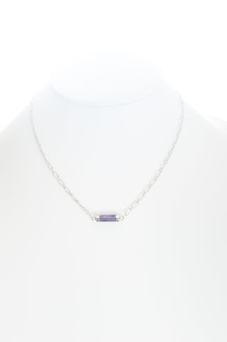Amethyst barrel set in silver with silver-filled chain