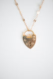 Gold heart-shaped locket and gold-filled chain
