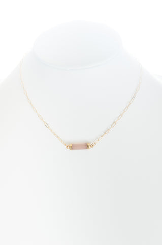 Chalcedony (pink) barrel set in gold with gold-filled chain.