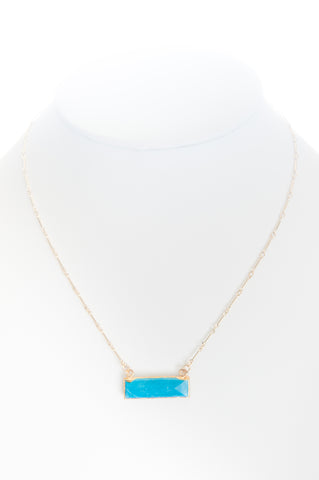 Howlite (turquoise) set in gold with gold-filled chain