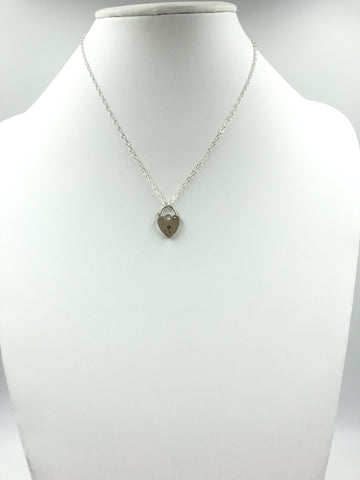 Silver heart-shaped locket and silver chain