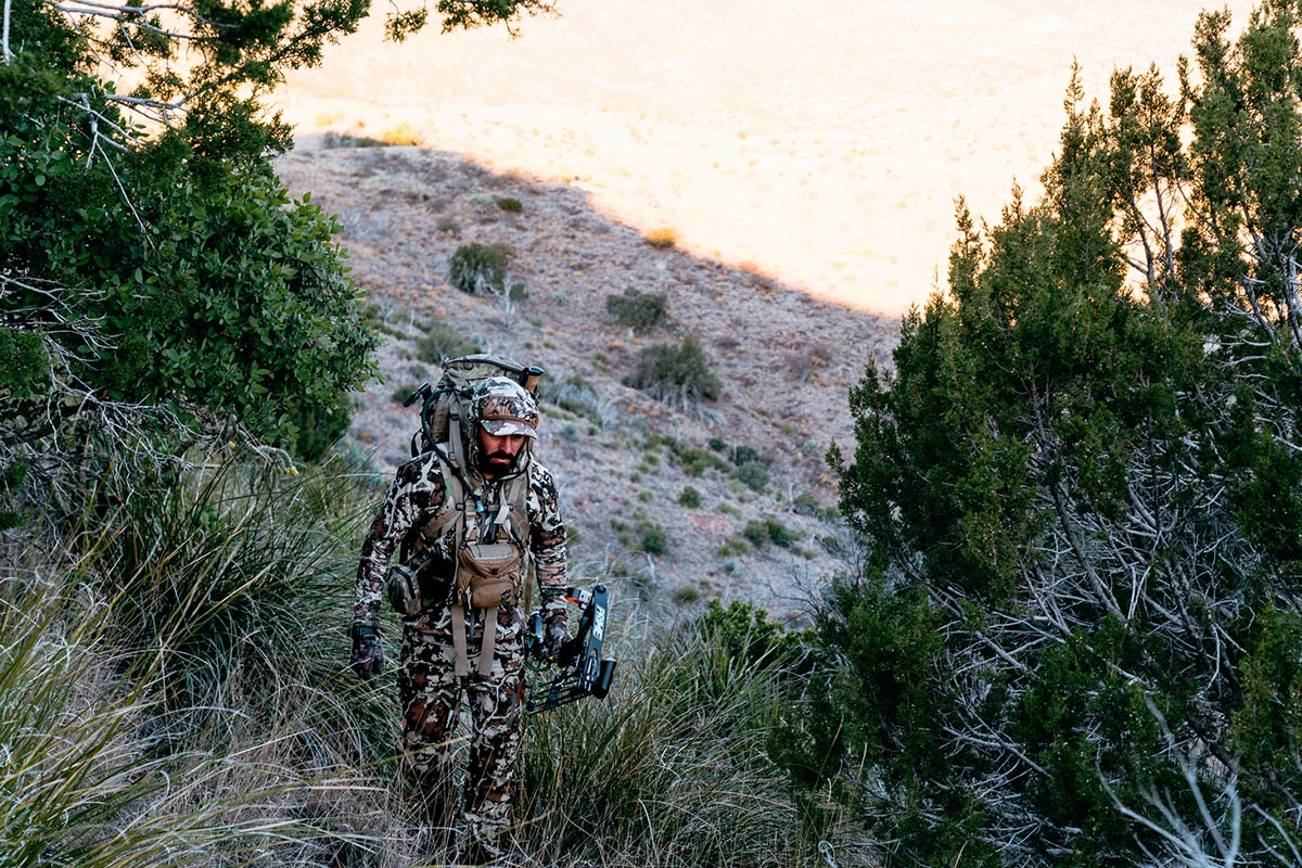 Bowhunter Hiking with Pack