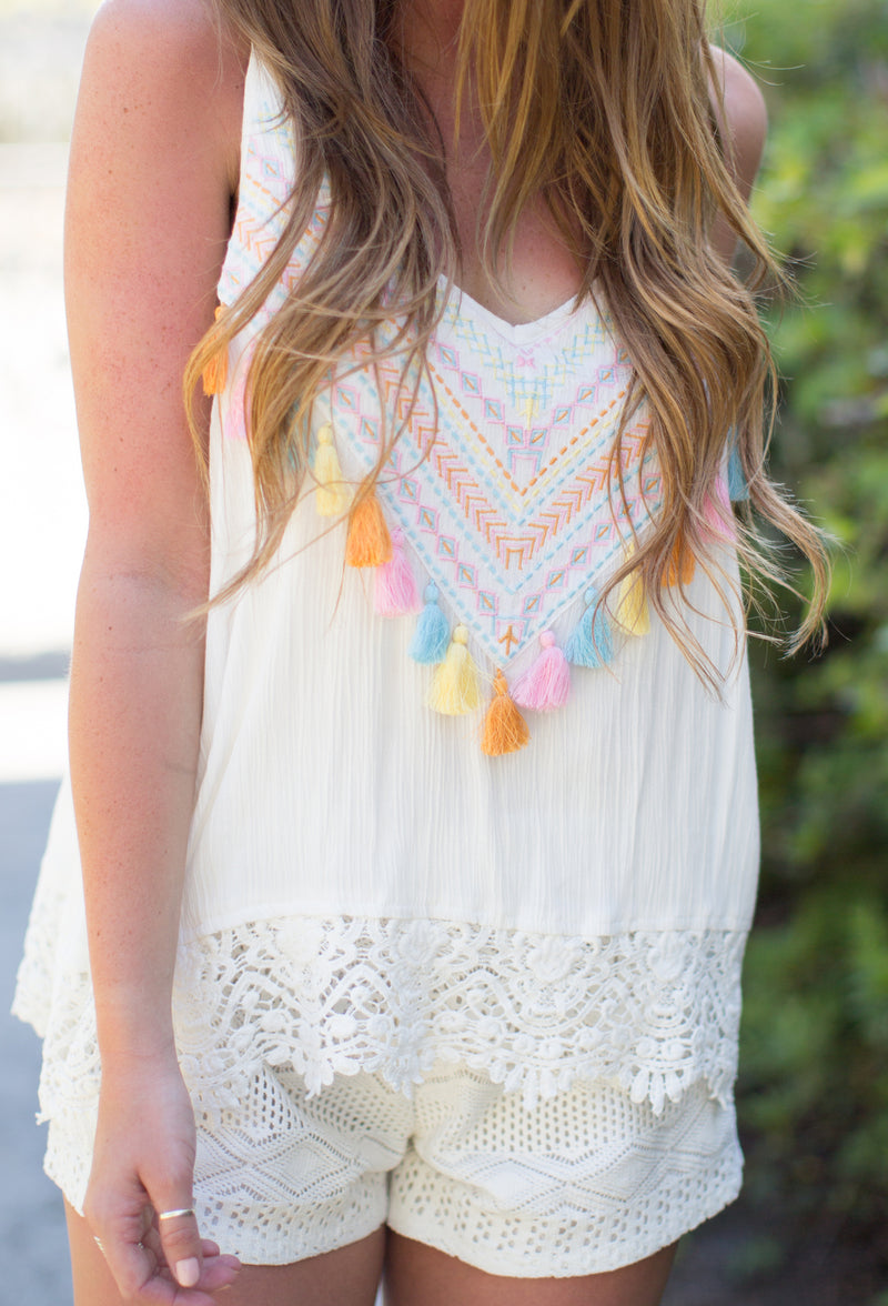 JUDITH MARCH CREAM ROMPER WITH TASSELS