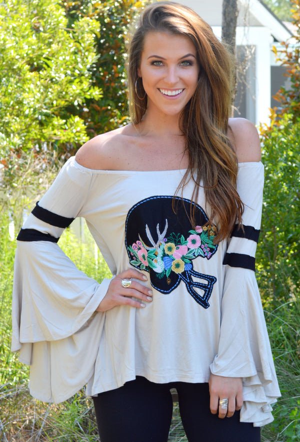 OFF THE SHOULDER JUDITH MARCH TOP WITH BLACK FOOTBALL FLORAL FOOTBALL HELMET